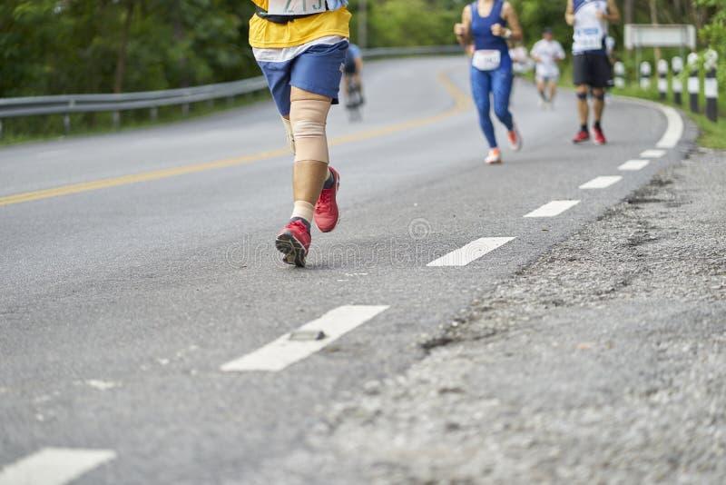 Marathon running race, Run up the mountain road stock photo