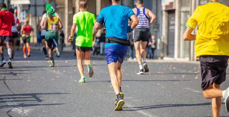 Marathon running race, runners running on city roads royalty free stock photos
