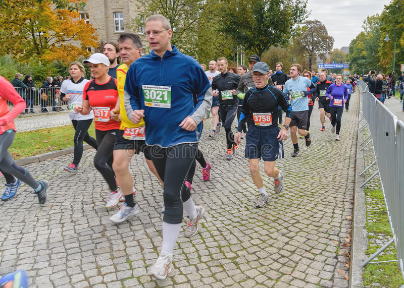 Marathon. Sport holiday in Germany, Magdeburg, 18 oktober 2015. Men and women run a marathon. Marathon race at 42 kilometers. Sport holiday in Germany, Magdeburg stock photography