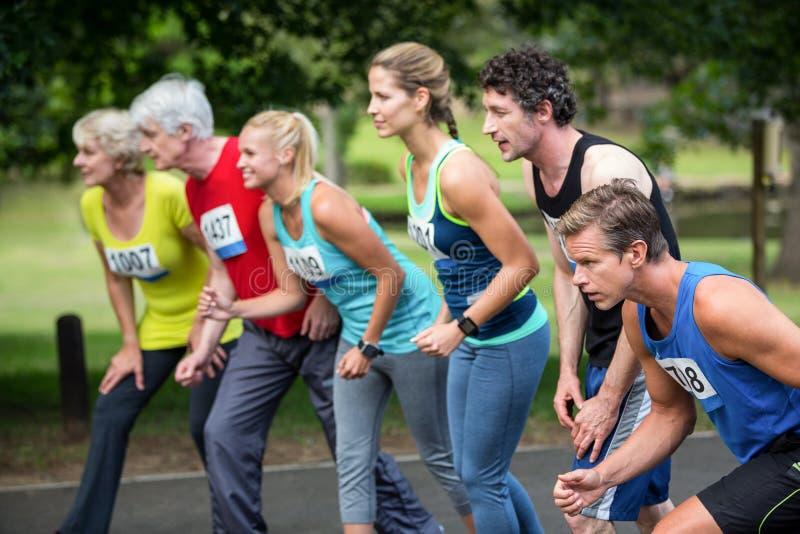 Marathonathleten auf der Anfangszeile stockfoto