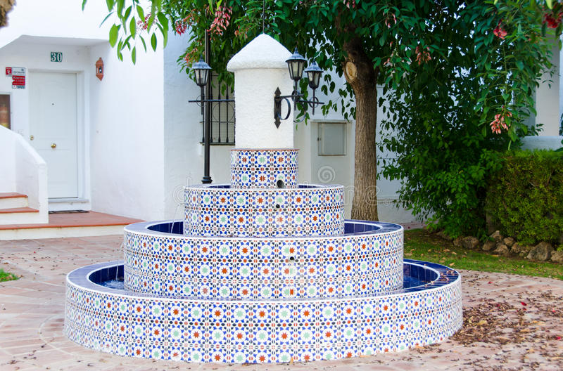 Marbella, Andalusian style fountain, on July 2015, Southern Spain. stock photo