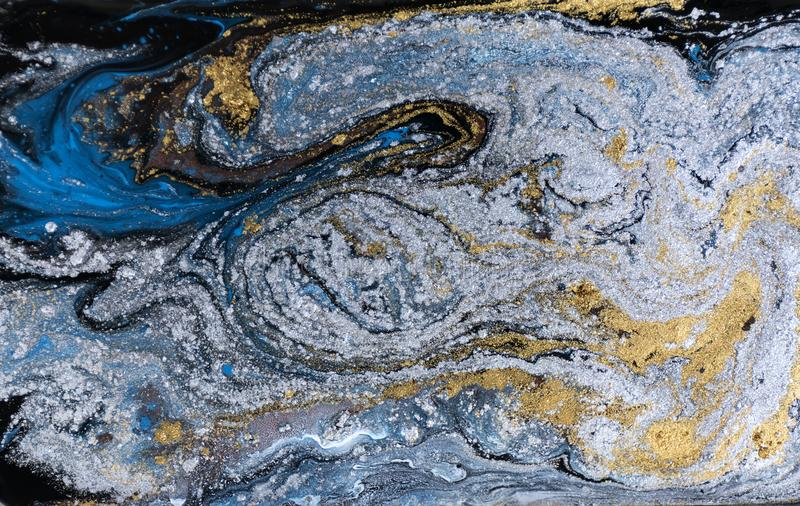 Marble abstract acrylic background. Nature blue marbling artwork texture. Gold and silver glitter. stock images