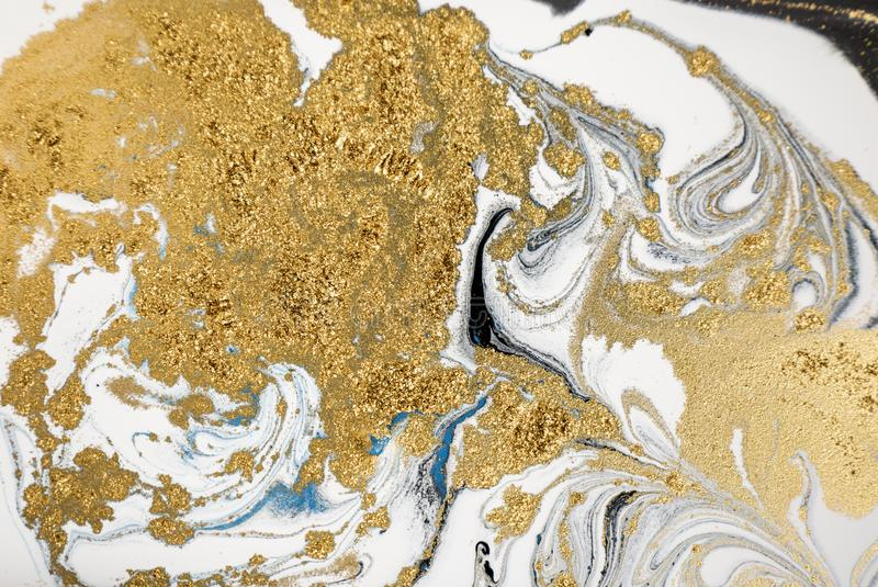 Marble abstract acrylic background. Nature marbling artwork texture. Golden glitter. Marble abstract acrylic background. Nature marbling artwork texture. Golden stock photos