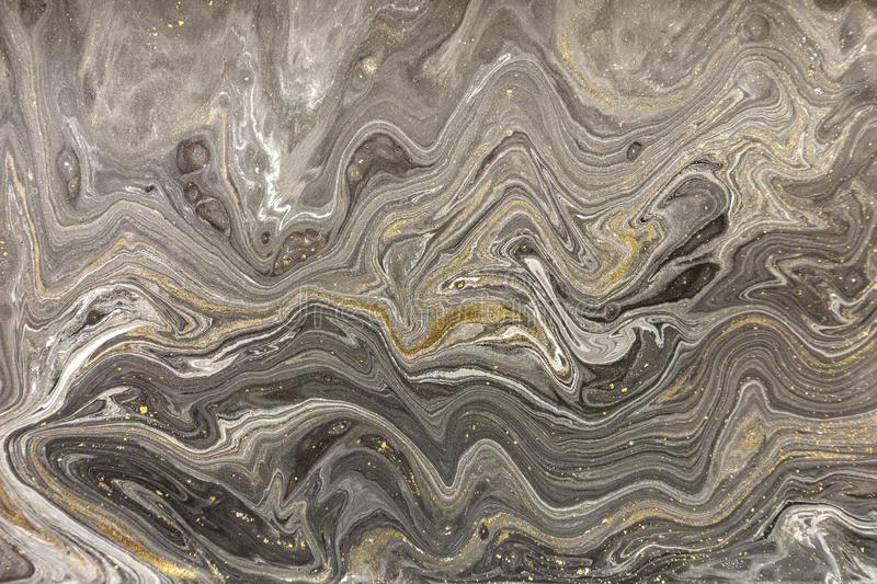 Marble abstract acrylic background. Nature marbling artwork texture. Golden glitter royalty free stock image