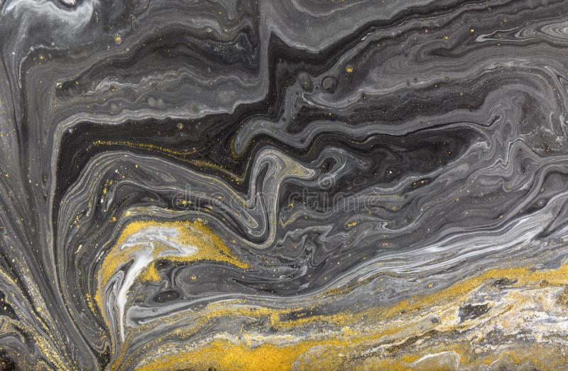 Marble abstract acrylic background. Nature marbling artwork texture. Golden glitter stock photography