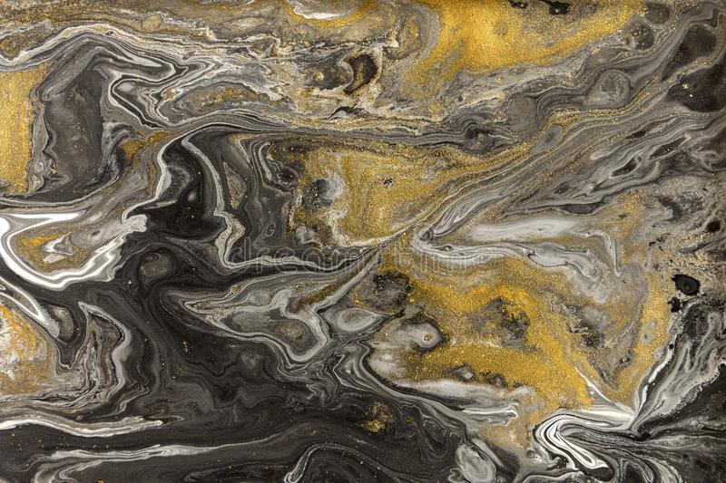 Marble abstract acrylic background. Nature marbling artwork texture. Golden glitter stock photo