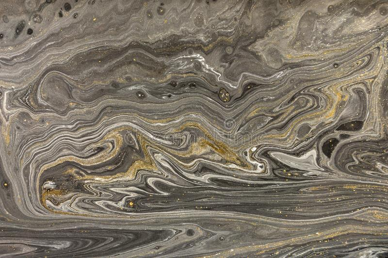 Marble abstract acrylic background. Nature marbling artwork texture. Golden glitter stock image