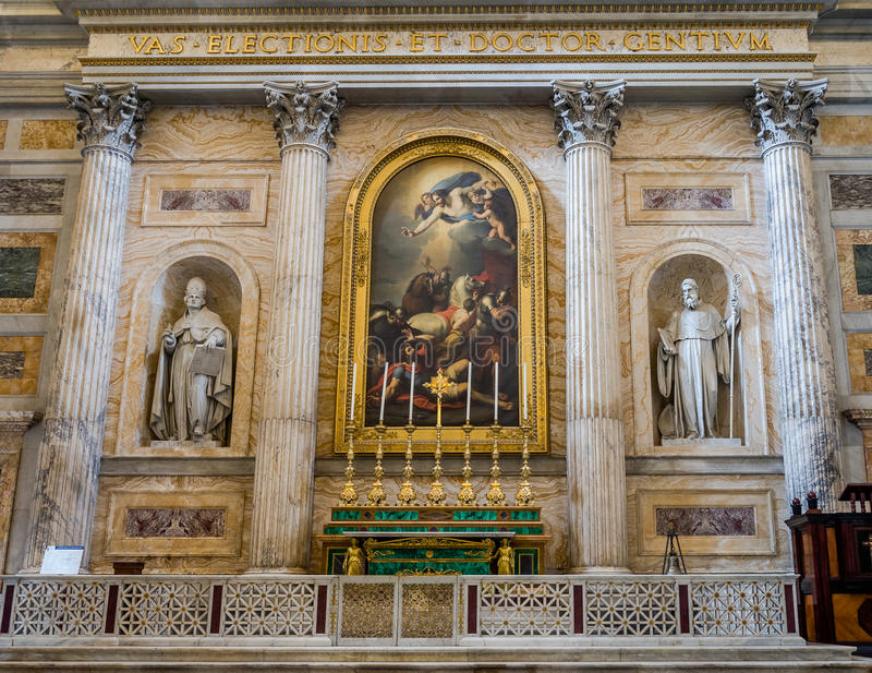 Marble altar with paintings and statues among the columns in the catholic church cathedral basilica of Saint Paul in Rome, Italy royalty free stock photo