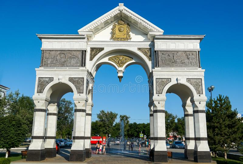 Marble Arch at the entrance to the alley of heroes of the Astrakhan land. Russia. / Astrakhan. Astrakhan Kremlin Fortress. Assumption Cathedral and the bell stock photography