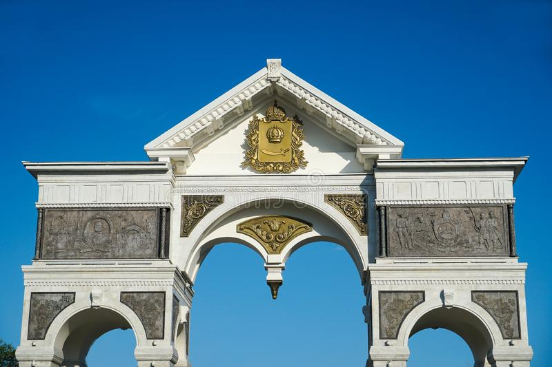 Marble Arch at the entrance to the alley of heroes of the Astrakhan land. Russia. / Astrakhan. Astrakhan Kremlin Fortress. Assumption Cathedral and the bell royalty free stock photos