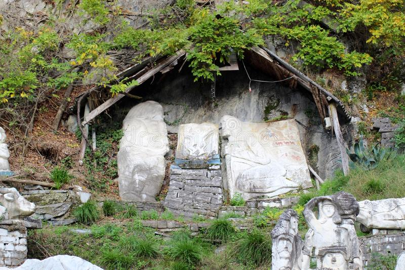 The marble art in the mountains. The abandoned house in the mountains. Nobody is living there anymore. You can see the trees,plants growing free out them selves stock image