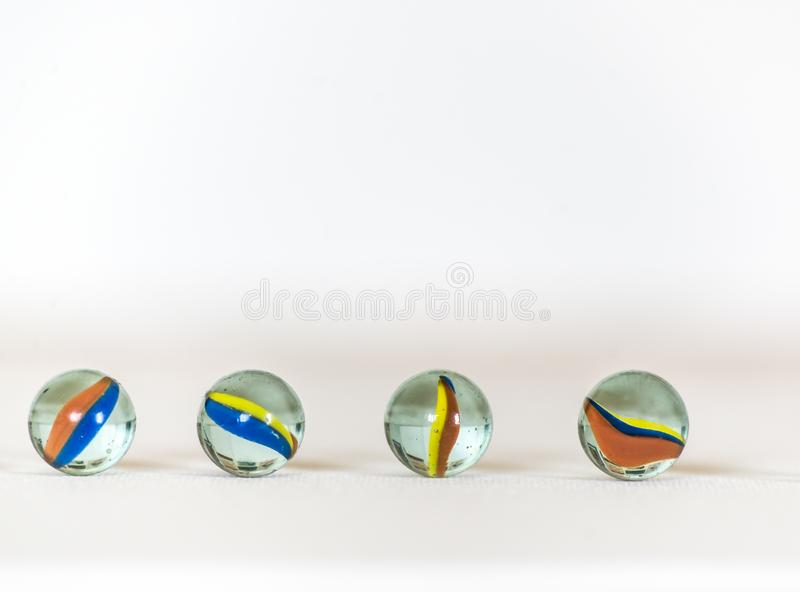 Marble balls, colorful and  in white background stock image