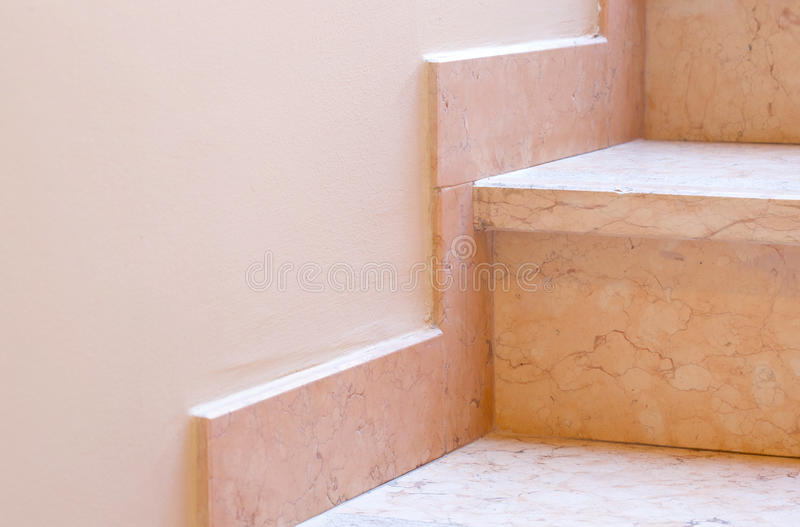 Marble baseboard at marble stairs. Closeup. Marble baseboard at marble stairs in the building. Closeup royalty free stock photography