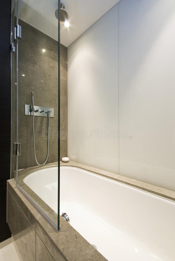 Download Marble Bath Tub With Slim Line Shower Attachment Stock Image - Image: 12239353