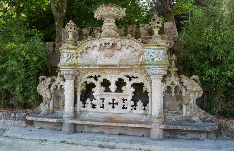 The marble bench in the garden of Quinta da Regaleira estate. Sintra. Portugal royalty free stock image