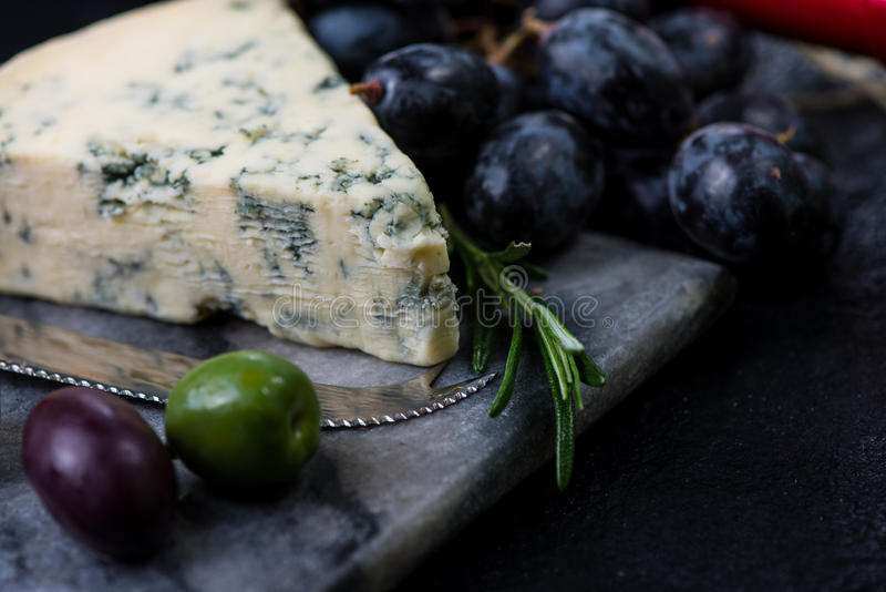 Marble board with cheese selection, wine and grapes stock image