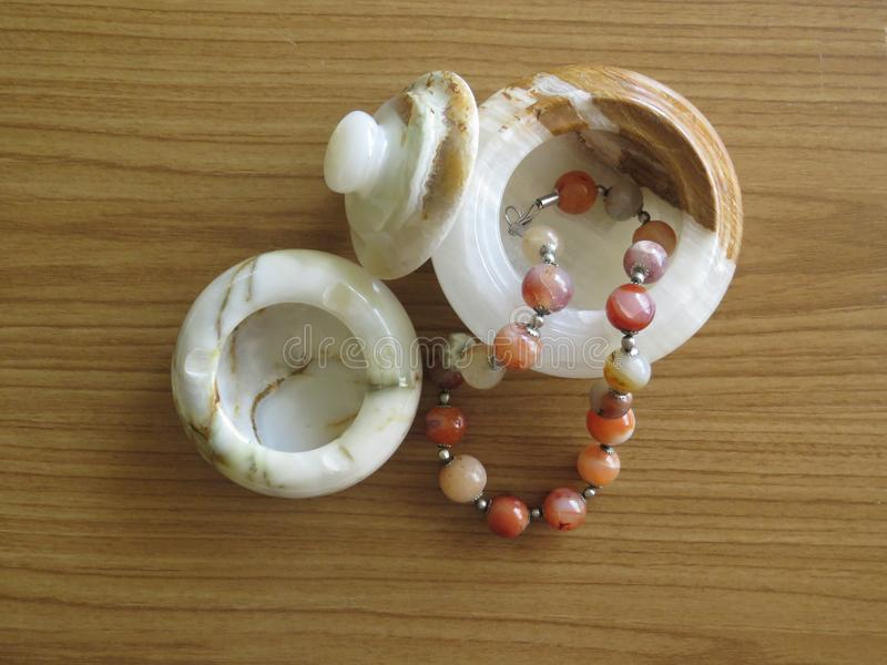 Marble box. Necklaces made of semi precious stones. Decorative design and handicraft. Marble box. Necklaces made of semi precious stones. Decorative design and stock photos