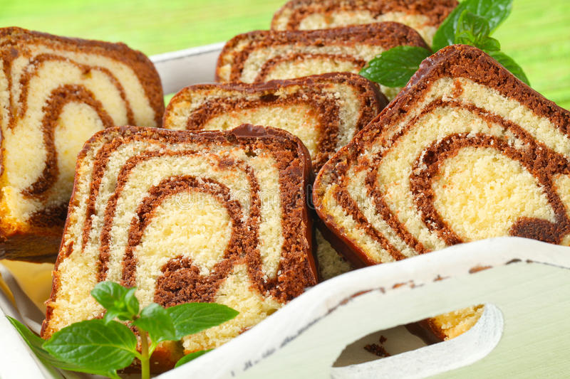 Marble cake. Slices of marble cake with chocolate icing stock images