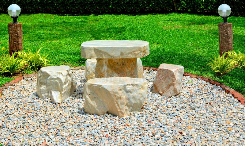 Download Marble Chair On Pebbles In Garden Have Grass Background. Stock  Photo   Image Of