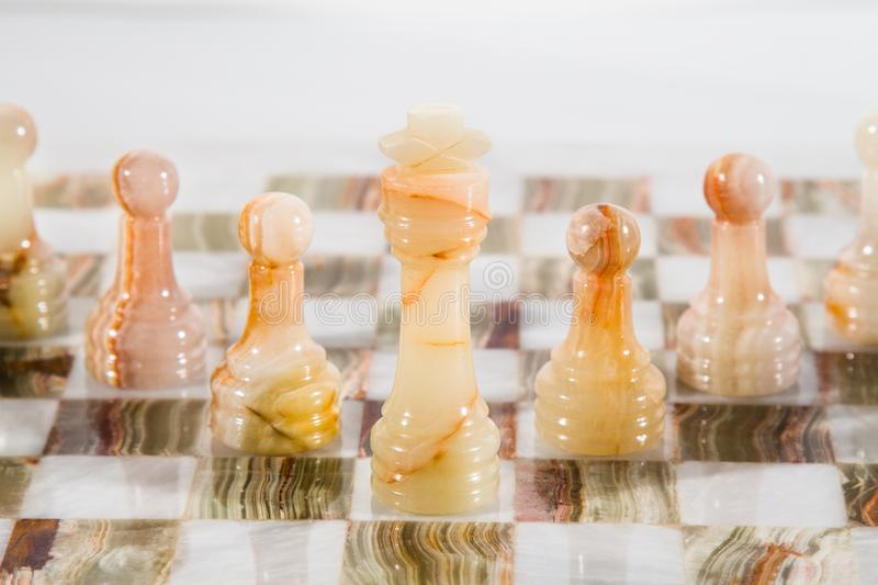 Marble chess in white. White pawn is coming royalty free stock images