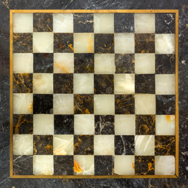 Marble Chessboard. Black e golden empty marble chessboard stock photo