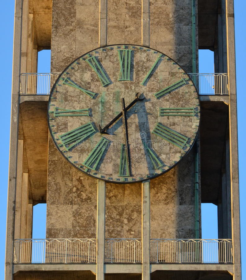 Marble clock, city hall tower, Aarhus Denmark. The large marble clock on the modernist tower of Aarhus, city hall, also in gray marble stock image