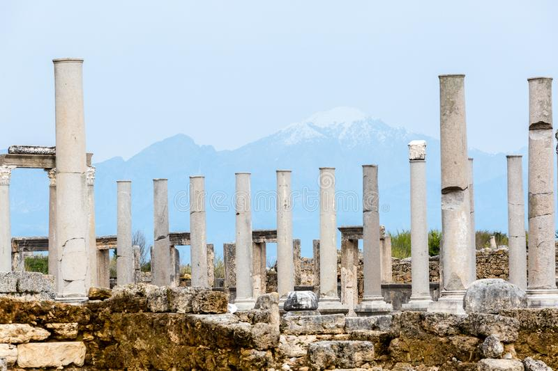 Marble columns on a background of mountains in the Ancient city of Perge near Antalya, Turkey stock photos