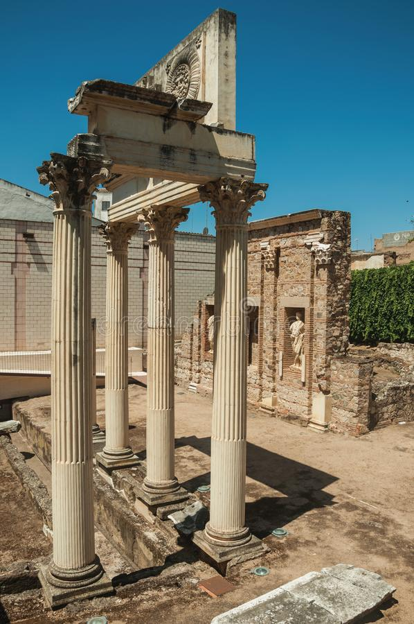 Marble columns and statues of Roman Forum building in Merida. Richly decorated Corinthian-style marble columns and statues reminiscent of Roman Forum building in stock photo
