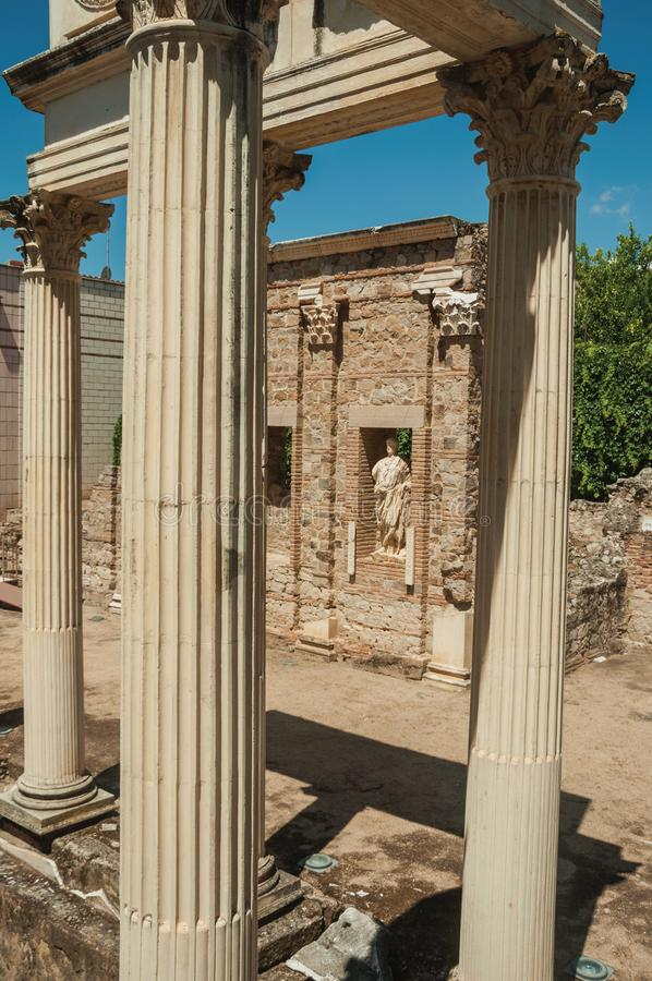 Marble columns and statues of Roman Forum building in Merida. Richly decorated Corinthian-style marble columns and statues reminiscent of Roman Forum building in royalty free stock image