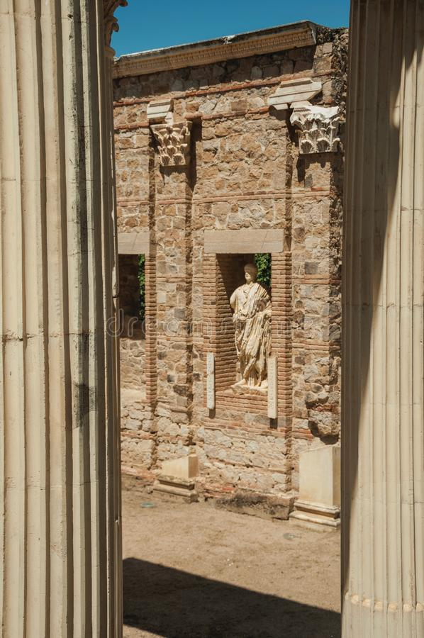Marble columns and statues of Roman Forum building in Merida. Richly decorated Corinthian-style marble columns and statues reminiscent of Roman Forum building in stock photography