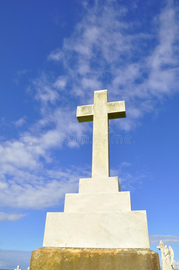 Marble cross headstone. stock image
