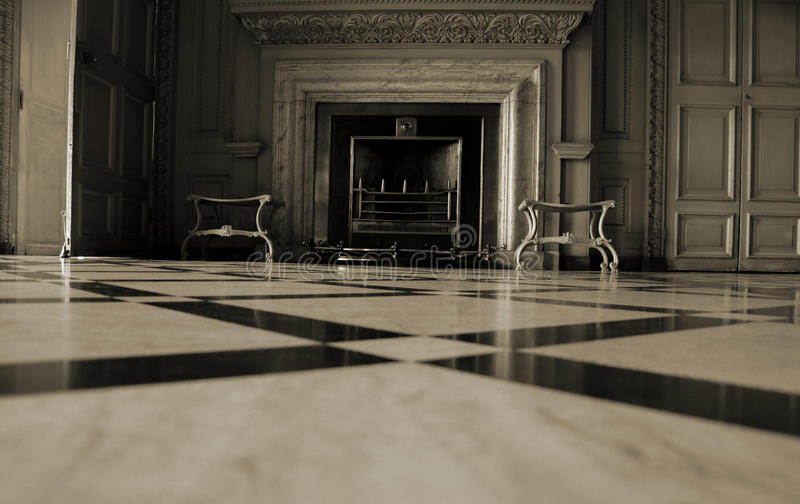 A marble fireplace. A beautiful marble fireplace at Petworth House stock photos