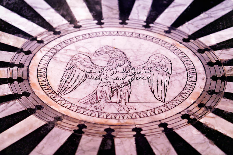 Marble floor with eagle as Cathedral interior in Siena royalty free stock image