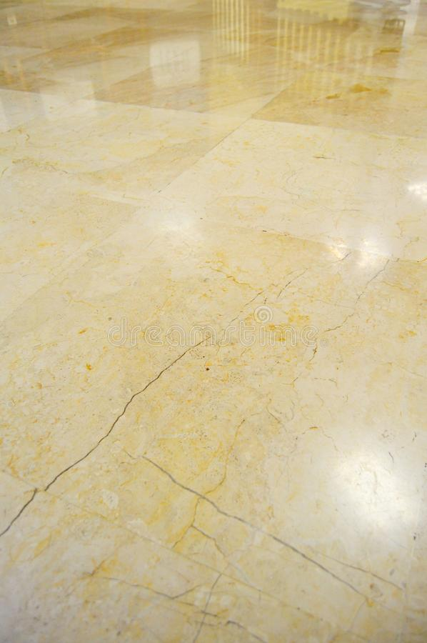 Marble floor tiles. Cracked, lights. stock images