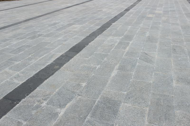 Marble flooring as foot path. Marble flooring foot path created for people to walk in isha yoga foundation coimbatore, tamilnadu, india stock photography