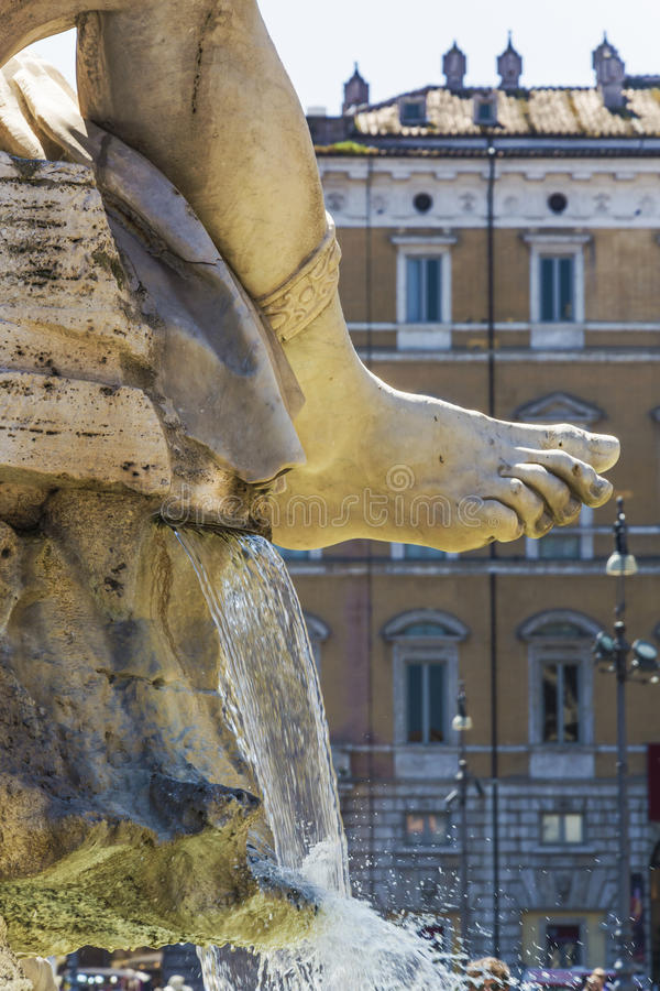 Marble foot. The marble foot of Rio de la Plata statue with gushing water in piazza navona, Rome royalty free stock photo