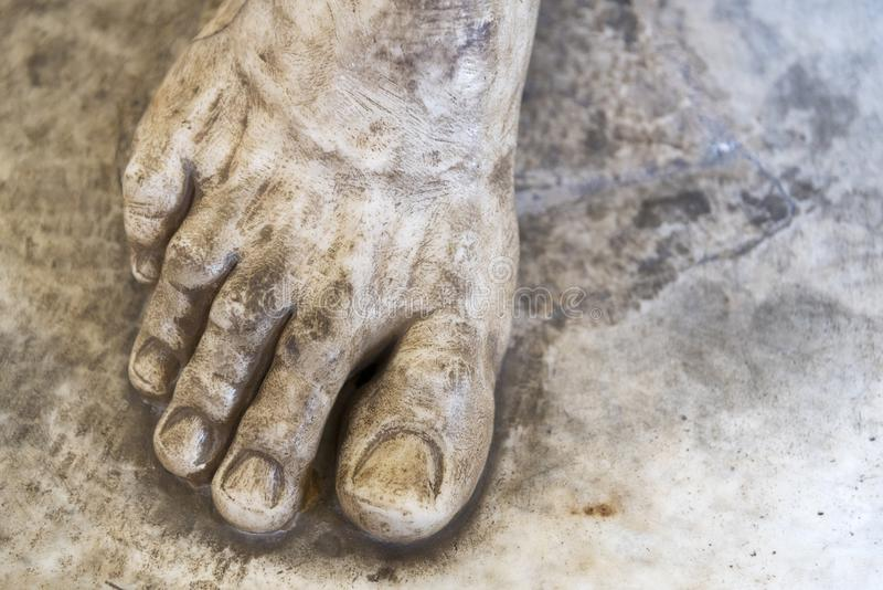 Marble foot of the sculpture close up. The attraction of the Museum stock images