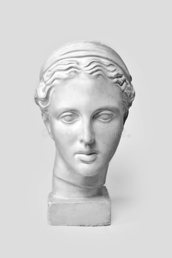 Marble head of young woman, ancient Greek goddess bust. Sculpture executed in accordance with modern standards of beauty. Isolated on white background royalty free stock photo