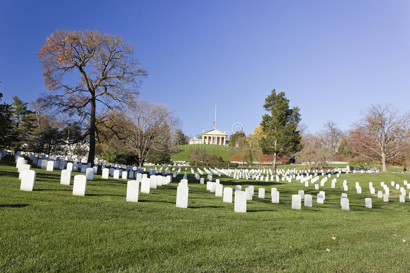Marble headstones in Section 32 at Arlington National Cemetery with Arlington House above royalty free stock images