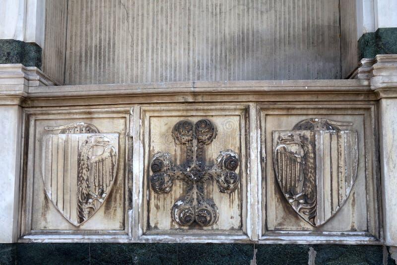 Marble Heraldic Shields, Santa Maria Novella Basilica, Florence. Detail of dirty and stained marble heraldic shields on the exterior of the Basilica Santa Maria stock photography
