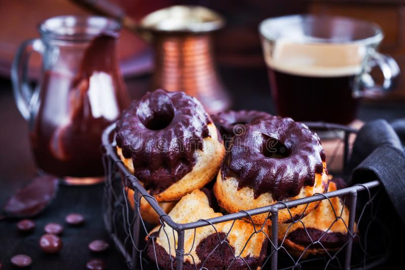 Marble mini bundt cakes with chocolate frosting royalty free stock photos