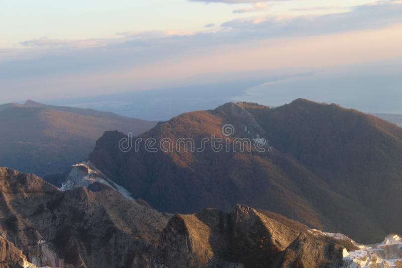 The marble mountains in Italy. This is Campo Cecina in Tuscany , Italy. These are the mountains of the marble. It is really on top of the beautiful mountains stock photo