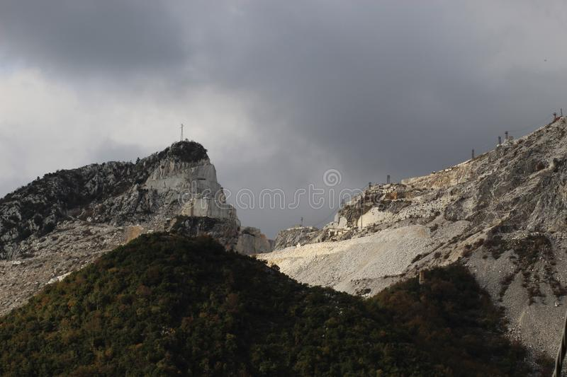 The Marble mountains in Italy. These mountains have marble caves. These marble caves you can find in Italy . Toscana ,Carrara royalty free stock image