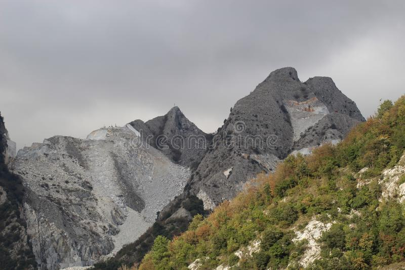 The marble mountains in Italy. This is one of the caves of marble where people work to get the marble to sell over whole wide world royalty free stock photography