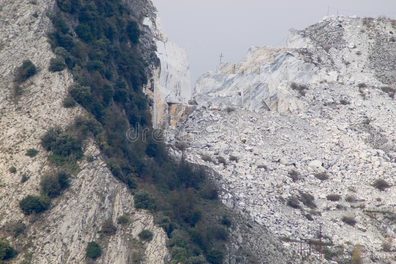 The marble mountains in Italy. This is one of the caves of marble where people work to get the marble to sell over whole wide world stock images