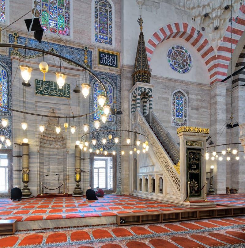 Marble ornate minbar Platform and niche, Suleymaniye Mosque, Istanbul, Turkey. Istanbul, Turkey - April 19, 2017: Marble floral golden ornate minbar Platform and royalty free stock images