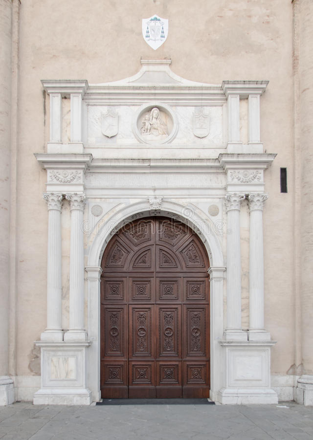 Marble portal in Gothic-Renaissance style of the dome in Montagnana, Italy. Marble portal in Gothic-Renaissance style of the cathedral in Montagnana, Italy royalty free stock image