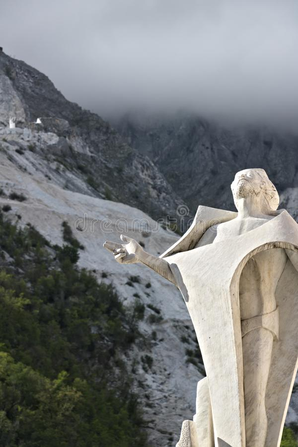 Marble quarries in Colonnata and monument to the quarryman.  The town is famous for the lardo di Colonnata and for the extraction stock image