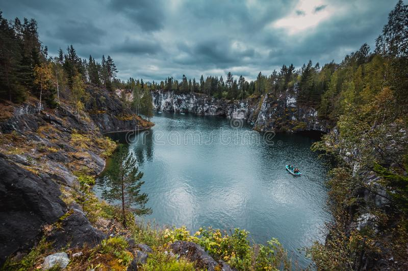 Marble quarry in Ruskeala Mountain Park, Karelia. Karelia, Russia - August 18, 2015: Marble quarry in Ruskeala Mountain Park.The Ruskeala marble deposit was royalty free stock images