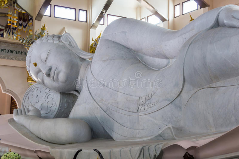 Marble of Reclining Buddha statue in Temple of watpaphukon. stock photo